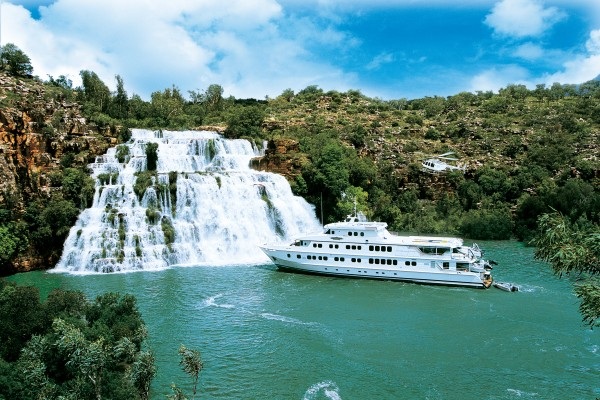 Cruise ship near a waterfall,; Wilderness Australia;